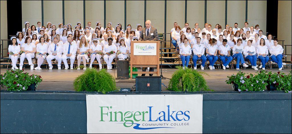 Nurses and nursing students on risers at graduation