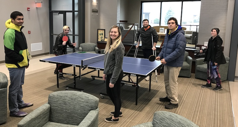 Students around a ping pong table