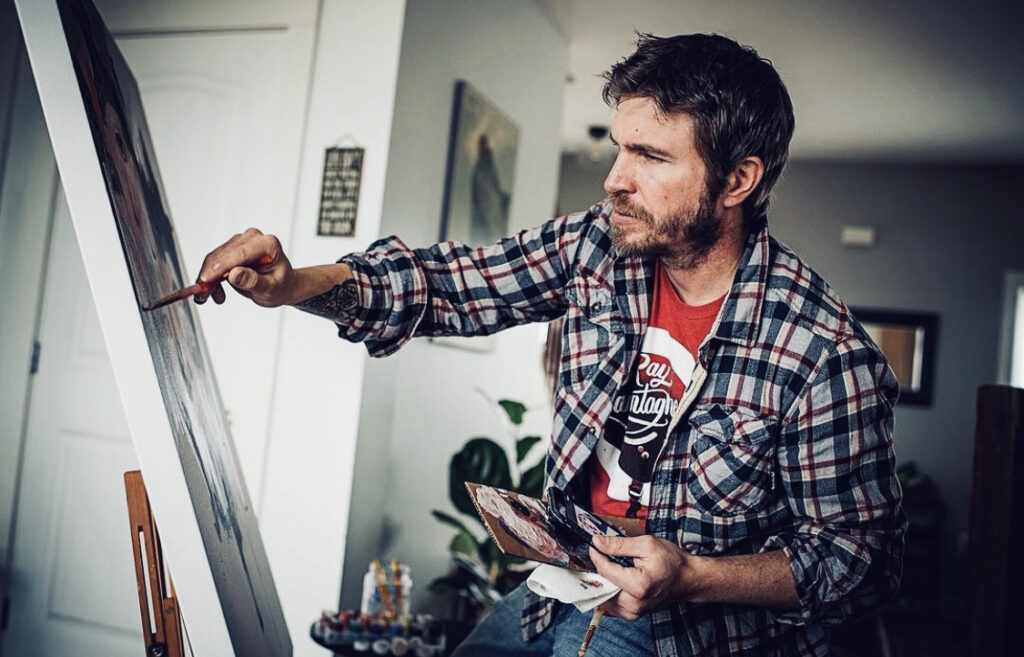 Picture of artist Chad Cleveland painting