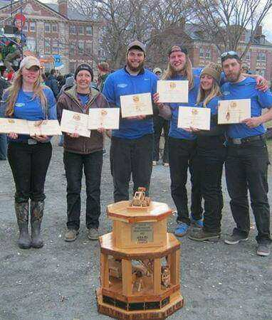 FLCC Logging Sports team with wooden trophy