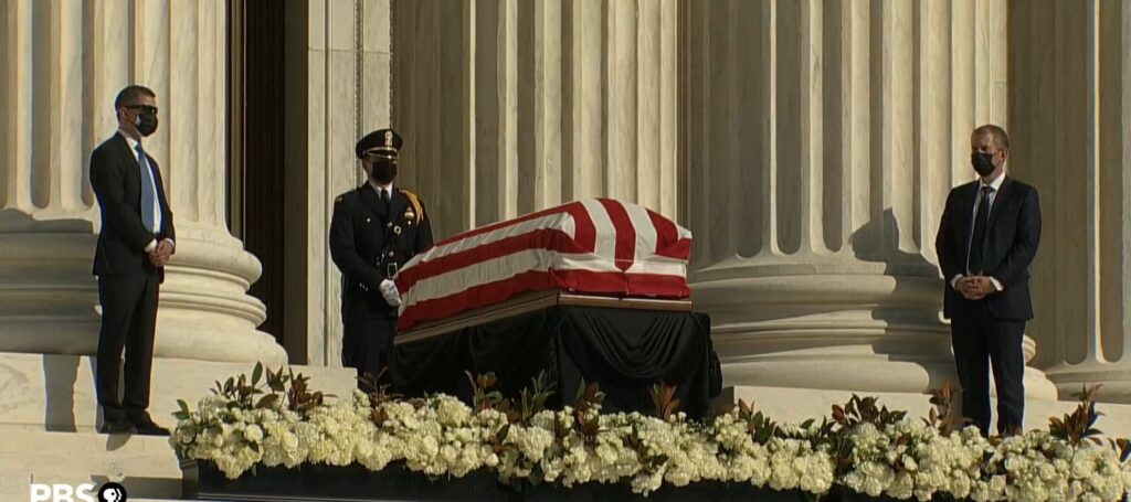 Three officers near the casket of Ruth Bader Ginsburg