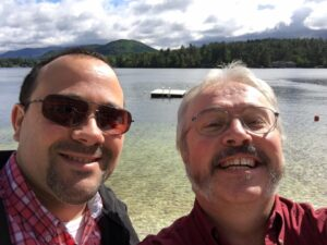 Photo of Bill Pealer and Bill White in front of a lake