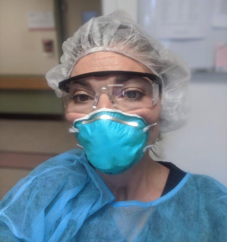 Woman in full PPE